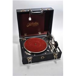 Antique Melody by Caswell gramophone manufactured in Milwaukee, USA in portable carrying case, worki