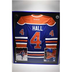 Shadow box framed handsigned blue and orange No. 4 Hull Oilers jersey with promo photos and pucks