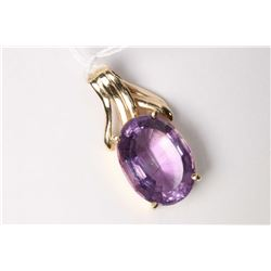 Ladies 18kt yellow gold and oval mixed cut 9.25ct amethyst gemstone. Retail replacement value $1,100