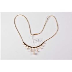 Lady's 14kt yellow gold necklace set with 12 graduating genuine pearl necklace