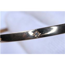 Lady's 14kt yellow gold bangle set with 12 small accent diamonds, note missing one stone