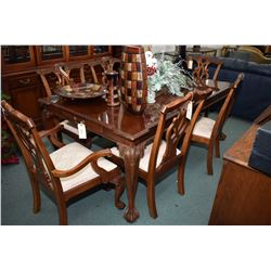 Chippendale style mahogany dining room table with carved ball and claw feet and two large insert lea