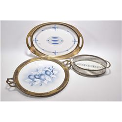 Three antique porcelain trays, all with brass and steel galleys