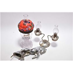 Mustang cast and chrome plated hood ornament, a miniature dual branch oil lamps and a colourless min