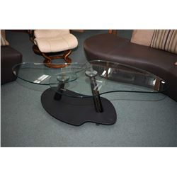Model Kendo coffee table with metal base and two rotating glass table tops made by Reflex, originall