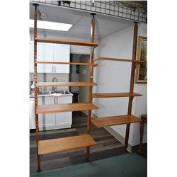 Danish made mid century modern teak wall unit with three spring loaded uprights and eight adjustable