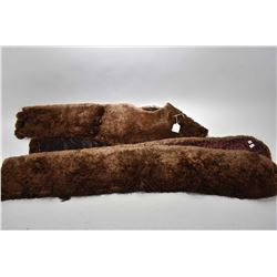 Vintage winter carriage ride items including large furry muff, thick collar with long tails and two
