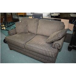 Quality single size loveseat/hide-a-bed made by Barrymore, purportedly never used, originally retail