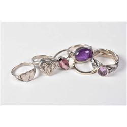 Selection of sterling silver rings including gemstone set rings, engraved heart shaped locket ring,