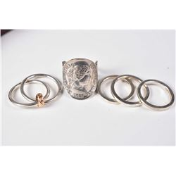 Selection of sterling silver rings including three stacking rings, a double ring with gold and a sil
