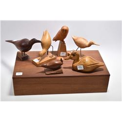 Six hand carved wooden birds, all signed or labelled by artist Randall Coles plus a wooden lidded bo