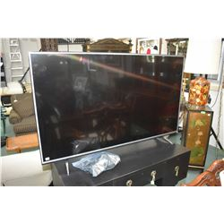 LG model 55UH6150 flat screen television with remote