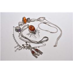 Selection of vintage collectible jewellery including sterling silver necklaces, rings, spider brooch
