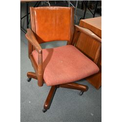 Vintage open arm swivel office chair made by Krug