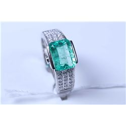 Lady's 14kt white gold, diamond and emerald gemstone ring set with 1.50ct emerald cut emerald gemsto
