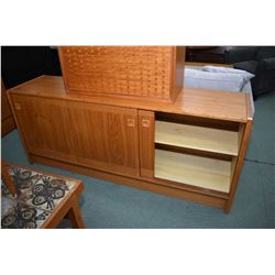 Mid century modern teak dining room credenza with two sliding doors, one exposing single drawer made