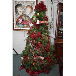 Fully decorated and illuminated artificial Christmas tree decorated at the Festival of Trees plus a