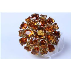 Lady's 18kt yellow gold and citrine gemstone ring set with 7.85ct of oval mixed cut citrines. Retail