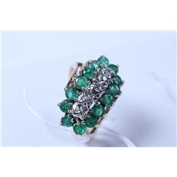 Lady's 10kt yellow gold, emerald and diamond gemstone ring set with .45ct of diamonds and 1.26ct of