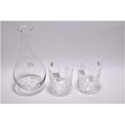 Tiffany & Co. crystal decanter sans stopper and two Waterford crystal tumblers