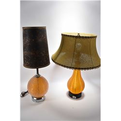 Two mid century table lamps each with textured acrylic bases