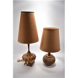 Two mid century table lamps including teak lamp with cork base and a teak and glazed pottery lamp
