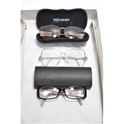 Three pairs of designer glasses including Yves Saint Laurent, Prada and Gucci, note all with prescri