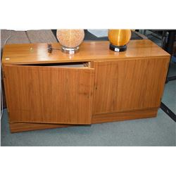 Mid century modern teak two door sideboard, one side exposing open shelf and the other exposing adju