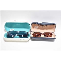 Two pairs of designer sunglasses including Oakley and Maui Jim