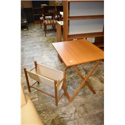 Two pieces of mid century furniture including Danish Spottrup folding table and a teak framed textil