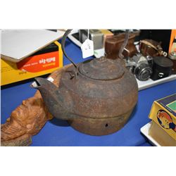 Antique cast iron water kettle and a carved wooden Indian bust signed by artist K. Kaiser
