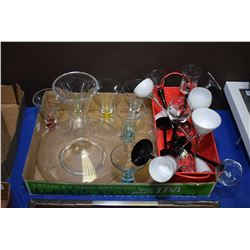 Selection of modern bar items including wine decanter, black and white glass stemware and a set of a