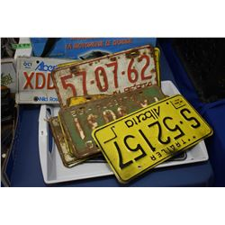 Selection of vintage Alberta licence plates including 1958, 1960, 1962, etc.