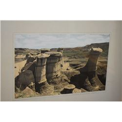 Two framed colour photographs including Hoodoos by Drumheller and Red Deer River by Drumheller