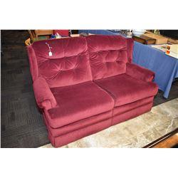 Two seater burgundy upholstered loveseat