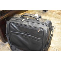 Leather Briggs & Riley leather carry-on bag and pull-out handle and wheels
