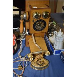 Two antique style phones including a push button wall phone and a French style bedroom phone