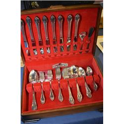 """Walnut canteen containing Rogers Bros. """"Remembrance' flatware including eight each of dinner knives,"""