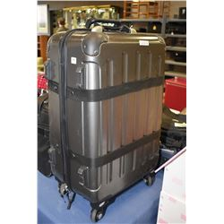Hard sided travel case with pull out handle and wheels