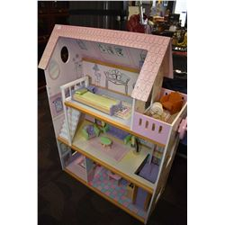 Child's dollhouse with assorted wooden furnishing and movable elevator