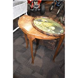 Matched grain English walnut back to the wall table and a convex glass picture frame with print