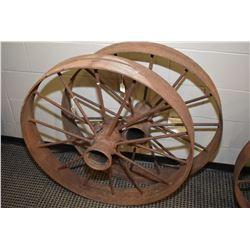 "Two vintage 34"" metal wagon wheels"