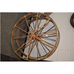 """Three vintage 34"""" metal wagon wheels"""