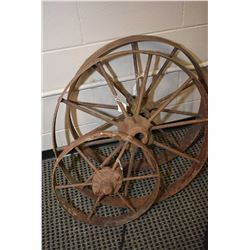 "Three vintage metal wagon wheel, two 26"" and one 16"""