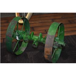 Pair of implement wheels on an axle