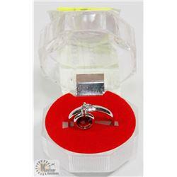#50-RED GARNET DANGLING RING