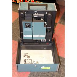BELL AND HOWELL 16MM PROJECTOR WITH LENSE