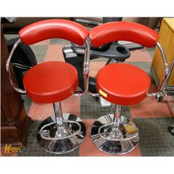 TWO RED LEATHERETTE BAR STOOLS WITH CHROME BASE