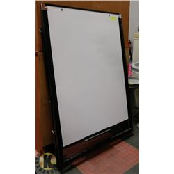 WHITE BOARD ON STAND.