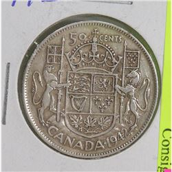 1942 CANADIAN SILVER 50 CENT COIN.